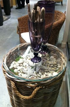 Everything Coastal....: Trend Alert: Design with Nautical Rope  Converted a basket into a table with the addition of a round piece of glass.  Add beach rocks and sea shells