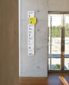 s t o r e s + s h o p s Stewart Hollenstein Architects – Green Square Library & Community Centre - C Directional Signage, Wayfinding Signs, Environmental Graphic Design, Environmental Graphics, Web Design, Game Design, Design Concepts, Hospital Signage, Navigation Design