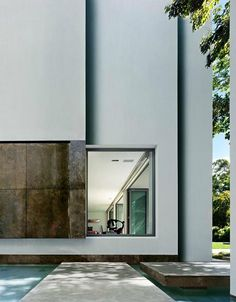 Nice contrast between the smooth white abstract plaster and the heavy materiality of the door.