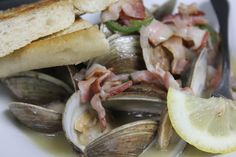 Little Neck Clams in a Lemongrass Beer Broth with Onions, Bacon & Jalapenos served with Ciabatta points.