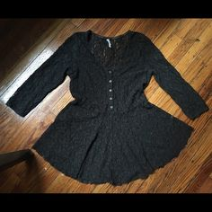 Free People black lace top Size medium. About an inch longer in the back than the front. Free People Tops