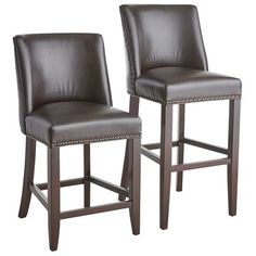 Corinne's larger seat and scoop back for added support provide deluxe style and comfort. With attractive bicast leather upholstery, bronze nailhead trim, padded seat and solid wood legs, these are well-bred little stools with superior genes.