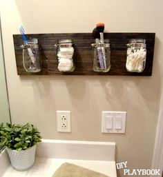 to Create an Easy DIY Mason Jar Organizer Mason jar bathroom organizer.I have some blue Mason jars I want to do this with.I have some blue Mason jars I want to do this with. Mason Jar Bathroom, Diy Bathroom, Master Bathroom, Bathroom Small, Bathroom Cabinets, Bathroom Plants, Bathroom Faucets, Bathroom Counter Storage, Bathroom Rack
