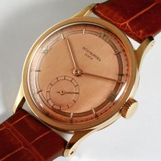 A wonderful 18ct Rose gold Patek Philippe watch, reference 570, made in late 1950s. Gold mirrored dial with applied gold indexes and Roman numerals with subsidiary seconds and hold hands. Case diameter 35 mm.
