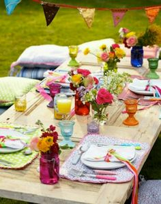 Outdoor party, beautiful colours - love the old door table top and little piles of cushions to sit on!