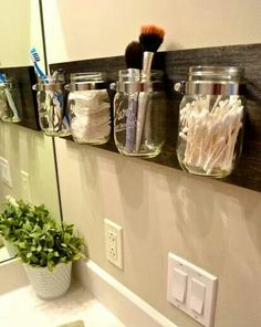 What a perfect organization technique for the makeup corner of a room/closet.