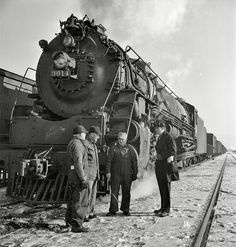 """January 1943. """"Freight operations on the Chicago & North Western between Chicago and Clinton, Iowa. The crew, with exception of the fireman, chat while waiting for orders to pull out."""" Photo by Jack Delano."""