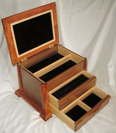 This box is Walnut and Bubinga with Maple drawers and deviders. Corner splines on lid and feet are Wenge. Linings are velvet and the lid insert is kidskin. The lid support is by Brusso. The top...