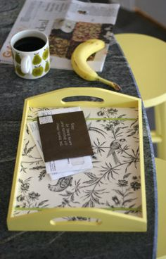 Instead of creating a permanent bottom in the tray like they do, cover a piece of cardboard with fabric and slip it into the tray. That way you can change it out for different themes or seasons! Another variation is to have a piece of glass cut for the bottom and switch out fabric or scrapebook paper underneath it.