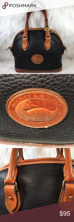 Small Vintage Dooney & Bourke Norfolk Case Small Vintage Dooney & Bourke Norfolk Case.  There are no ink marks on the inside. It is 23 years old so it doesn't look new on the inside but there are no damages, stains, snags or rips. Still smells new!!! As with all leather, especially brown, there are color variations. Please look at all pictures close up so you can see how wonderful this bag is. I have another listing with more pictures and information. Dooney & Bourke Bags