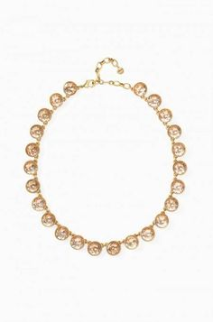 Peach sparkle necklace set in vintage gold, the Astor Sparkle Strand can be reversed for a solid gold look. Shop reversible necklaces at Stella & Dot.
