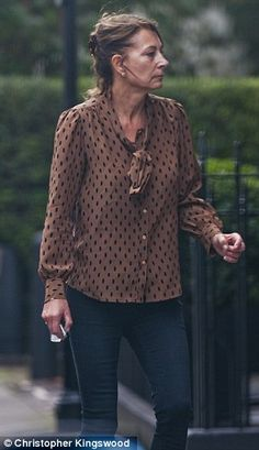 The 58-year-old matriarch was virtually unnoticeable as she left her daughter Pippa's London flat just before 11.30am