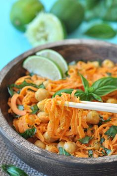 Spiralized sweet potato salad with chickpeas and a spicy and tangy sriracha lime peanut sauce. The perfect recipe for a hot summer day! www.veganosity.com