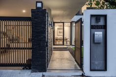 Kradoan House by Thiti Ophatsodsai: Serenity with Nature in Urban lifestyle of Bangkok - CAANdesign Door Gate Design, House Gate Design, Fence Design, Modern House Design, Compound Wall Design, Modern Fence, House Entrance, Facade House, House Plans