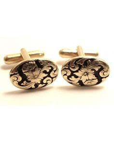 Gold & Black Flower Cufflinks  Vintage cufflinks with gold and black flower etchings. These cufflinks are great to wear for weddings and other formal gatherings.