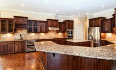 LOVE LOVE LOVE Dark cabinets. maple kitchen with black and brown countertop - Google Search