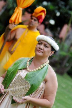 Aloha Festivals Opening Ceremony, Lady in waiting with her lauhala fan, Royal Hawaiian Center, Waikiki, Hawaii