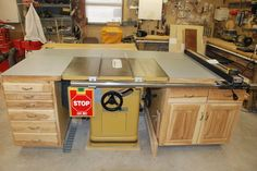 Built in Powermatic table saw not just a want. Table saws are the most used tool in the shop.