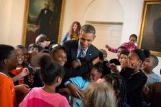 President Barack Obama hugs children participating in the White House Healthy Kids & Safe Sports Concussion Summit, in the East Garden Room of the White House, May 29, 2014. The President met with the group indoors when their South Lawn event was canceled due to weather. (Official White House Photo by Pete Souza)
