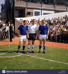 20th August 1966. Three world cup players Everton Alan Ball and Ray Wilson flanking Fulham's George Cohen at Craven Cottage on the opening day of the season.