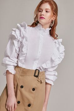 Button-up top channels vintage elegance with its high neckline and ruffle details,High neckline Ruffles on shoulders and around neck- Button closure in front. 80s Fashion, Modest Fashion, Hijab Fashion, Fashion Outfits, Womens Fashion, Fashion Trends, Le Polo, Mode Hijab, Blouse Designs