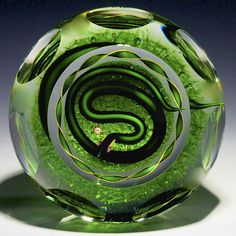"""James Kontes Paperweight: A Verde Green Serpent on Emerald mound with double row of side thumbprint facets. From artists personal collection. 2 7/8""""w x 2 1/4""""t, 15.9oz. - #0029"""