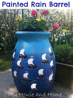 A rain barrel or planter gets a serious facelift when painted with an ocean's worth of sailboats, all adorned with flags painted by the young students in the class. Source: My House and Home