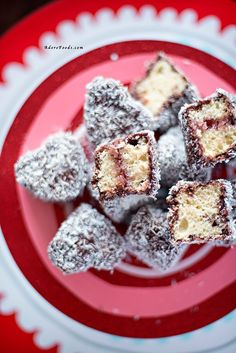 Heart shaped Lamingtons, delicious sponge cakes, dipped in chocolate sauce and covered in shredded coconut | Adore Foods