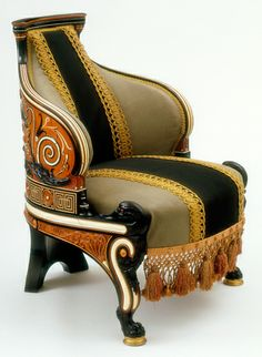 Pre-Raphaelite meets Aesthetique movement ~ Armchair designed by Lawrence Alma-Tadema and made by Johnstone, Norman & Co. (London 1884-6)  This awesome chair is made of mahogany, has cedar & ebony veneer, inlays of several woods, ivory and abalone shell.  It was designed for a 'Greek parlour' and belonged to Henry Gourdon Marquand, the second director of the Metropolitan Museum of Art in New York.