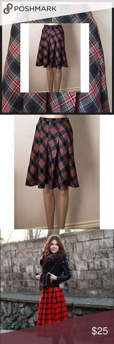 "BCBG vintage plaid skirt On trend for fall and winter: Great plaid skirt in a swingy silhouette. Would be awesome with boots. 3rd photo is just for styling inspiration, but is not the actual skirt. My mannequin is 5'8"". This should be knee-length on most people. Length 21.5"", waist 30"". BCBG Skirts Midi"