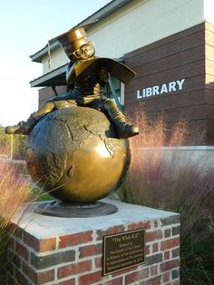 """""""Whiz Kid"""" statue in front of the Crestview Public Library"""