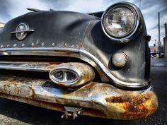 Love the rusty car!