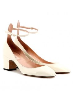 """A delicate ankle strap, single sole, and almond-shaped toe gives this pump the clean lines and fashion-forward vibe of a pointed toe, four-inch heel.Valentino """"Tango"""" patent-leather pumps, $895, Valentino.com."""