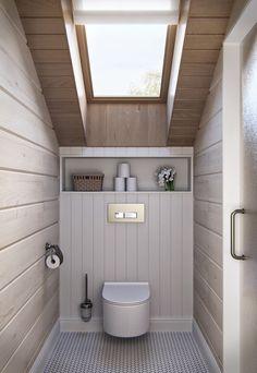 Toilettes rustique mais également modernes toujours avec des lambris en bois aux murs