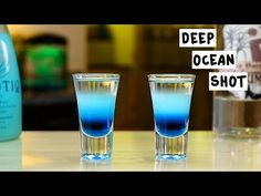 DEEP OCEAN SHOT 1 Part Blue Curaçao 1 Part Hpnotiq 1 Part Coconut Rum PREPARATION 1. Layer in shot glass in order shown above. DRINK RESPONSIBLY! Recipe inspired by: @sunshine_bartender