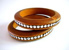 Offering wood bangle bracelets (2) with #silver accents and vintage:  These are a wonderful pair of wooden bangles with silver accents around the bangles.  They're wonderf...