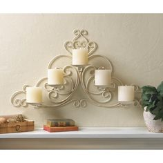 Vintage-style scrolled iron sconce holds five candles. Hang on a wall with flameless or regular candles for a beautiful glow.  Weight 3.5 pounds  26.2 x 1.1 x 14.2 inches tall  Iron  Candles not included