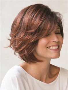 Dolce Wig by Noriko: Voluminous wavy layers softly graduate to the chin creating a chic, flirty bob.