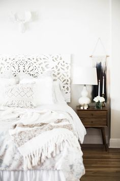 Amanda Holstein's cozy bedroom with white textures from Anthropologie and West Elm side table