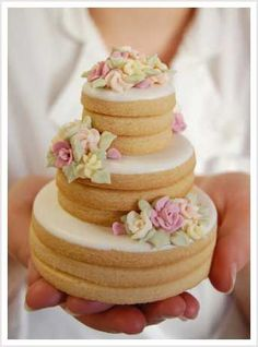 Cookies stacked and decorated to look like a mini wedding cake - cute for the bridal shower or other.