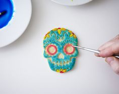 Mexican sugar skulls come to life in cookie form in this easy to make tutorial. A Cookie Stamp Set and some paintable food coloring make these cookies like filling in a coloring book. Ready to use sugar flowers and black food coloring markers make it easy to give each skull your own twist and make these a must for your Day of the Dead celebration. You need a really good roll out sugar cookie dough that keeps it's shape to make these cookies look really great. We're partial to our Ultimate…