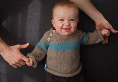 An easy top-down unisex sweater with handy roll-up tabs for tiny explorers. This sweater is completely seamless and has minimal finishing. Skills Required: knitting, purling, knitting in the round, increasing, decreasing, knitting on dpns, picking up stitches, yarn overGAUGE: 14 sts x 24 rounds = 4 inches (or 10 cm) in stockinette stitch using larger needlesApproximate yardage required: Main color: 160 (230, 240, 260, 280, 300) yards or 150 (210, 220, 240, 260, 275) meters Contrasting c...