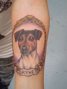 love the dog tattoos