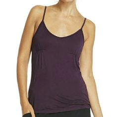 Fabletics Sweet Pea cami / ON SALE Its BNWT A little darker purple color.  This cami is more loose fitting, and can wear with jeans, shorts, legging, and whatever you want. Its adorable,  you can dress it up. Does not have bra support  Fits size 2 to a 10. Its a medium size. Fabletics  Tops Camisoles