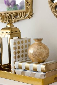 With these painted metallic books, you can totally makeover your decor cheaply…