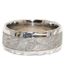 Unique 9mm Cobalt Chrome and Meteorite man wedding band. Cobalt edges with Meteorite Rock center for Unique Characteristic look for only $600 ! only at Windy City Diamonds.  # W087702  #windycitydiamonds #CC #cobaltchrome #cobalt #ring #menring #meteorite #meteoritering    www.windycitydiamonds.com