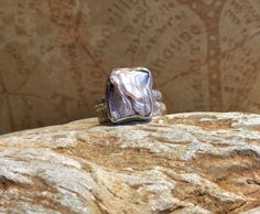Unique Handcrafted Biwa Pearl and Sterling Silver Ring. Great introductory price on this item. by Jewelriart on Etsy https://www.etsy.com/listing/255222129/unique-handcrafted-biwa-pearl-and