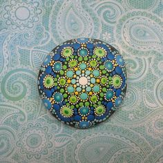 Mandala Stone by Kimberly Vallee: Hand painted with acrylic and protected with a matt finish, each stone is 2.5–3 inches diameter and is one-of-a-kind.