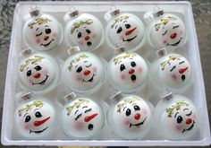 Aren't these super cute? Love this idea and think I could maybe make them... If not, I found them on etsy.  Set of 12 Hand Painted Snowman Ornaments. $60.00, via Etsy.