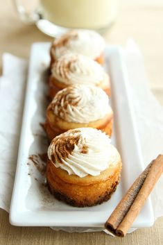 Mini Eggnog Cheesecakes with Vanilla Bean Whipped Cream